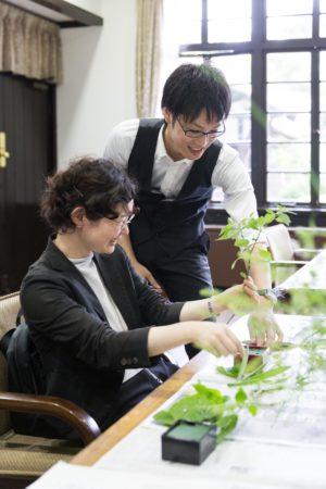 Professor Takabayashi helps a student